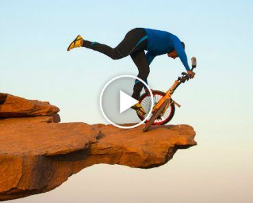 Clifftop BMX Yoga: Extreme 68-year-old Performs On Bike 300ft Above Ground 9