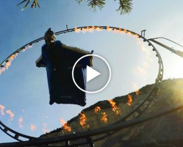 Man In Wingsuit Flies Straight Through a Ring Of Fire 6