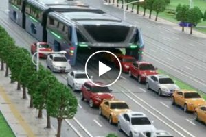 China Unveils Elevated Bus That Drives Over The Top Of Other Cars 11
