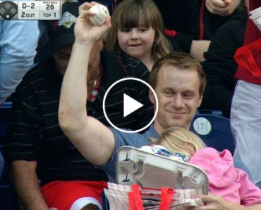 Dad Catches Foul Ball While Holding Sleeping Baby 4