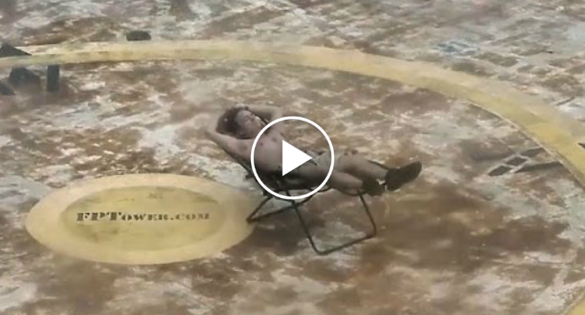 Man Lounges In The Middle The Of Ocean During Hurricane