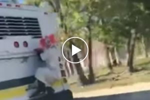 Creepy Clown Hitches Ride On Back Of Bus 10