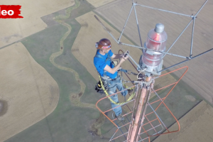 Watching a Man Change The Bulb In a 1500-Ft TV Tower Is Nerve-Wracking 11