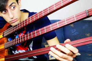 Musician Performs An Impressive Continuous Solo On A Really Odd Triple Neck 6-String Bass 9