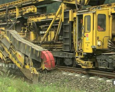 Say Hello To The Big Bad Machine That Lays Down Railroad Track 7