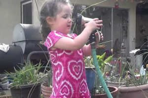 Little Girl Learns About Water Pressure With Her Grandmother 12