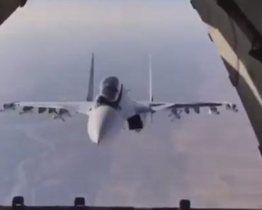 Close Escort Of A Cargo Plane Plays Game Of Peek-A-Boo After Cargo Drop 8