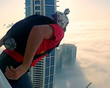 A BASE Jumper Takes A Leap Of Faith Into The Clouds 8
