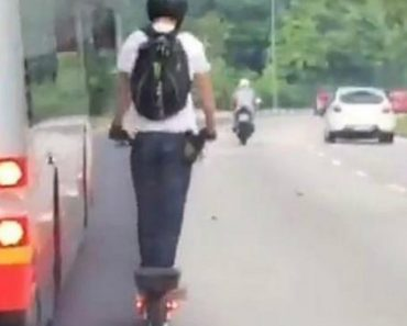 Insane Dude On An Electric Scooter Passes Bus At 45 Miles Per Hour 1