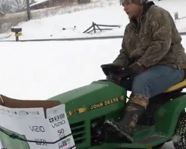 Clever Man Plows Snow Using A Large Cardboard TV Box Attached To The Front Of A Riding Lawn Mower 8
