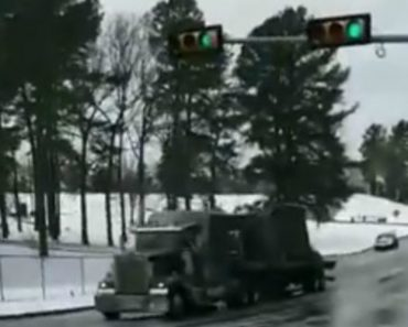 18-Wheeler Crashes Into Traffic Light After Trying To Climb Icy Hill 7