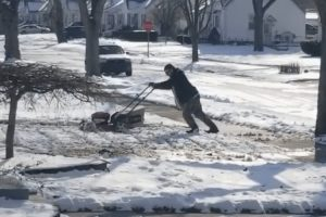Man Tries To Mow His Lawn That Is Covered In Snow 11