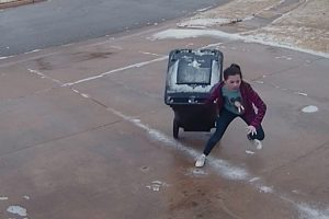 What a Chore for 11-Year-Old Trying to Carry Trash Can on Icy Driveway 9