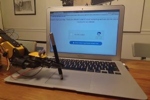"""A Robotic Arm Successfully Beats An """"I Am Not A Robot"""" CAPTCHA Using A Stylus On The Trackpad 10"""