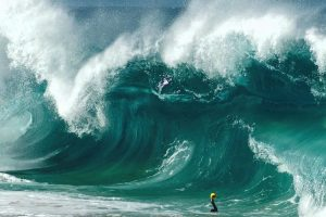 Brave Man Dives Into The World's Biggest Waves And What He Captures On Camera Is Spectacular 11