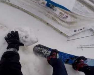 Urban Snowboarder Almost Falls Off Cliff Into Gas Station Parking Lot 3