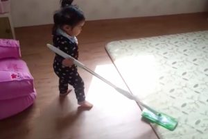 15-Month-Old Girl Loses It When Mom Tries To Take Her Favorite Mop Away 12