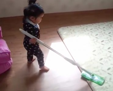 15-Month-Old Girl Loses It When Mom Tries To Take Her Favorite Mop Away 1