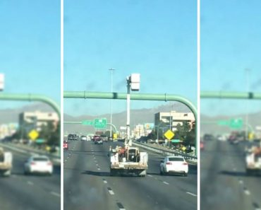 Utility Truck Driving Down A Highway With Its Bucket Extended Is A Real Nail Biter 1