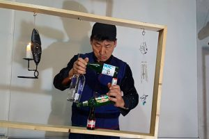 Balancing Expert Stacks Bottles To Form The Shape Of A Square Inside Of A Wobbly Wooden Frame 12