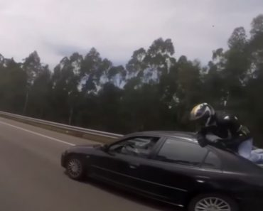 Biker Cheats Death As He Comes Off His Bike And Lands On Back Of Car 4