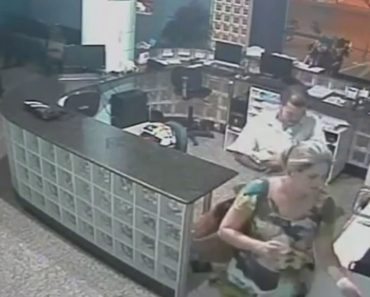 The Incredible Moment a Quick Thinking Receptionist Catches a Falling Tot After Bungling Dad DROPS Him 2