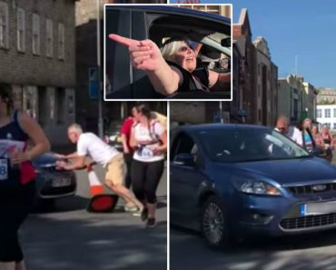 Woman Drives Into Path Of Furious Marathon Runners 9