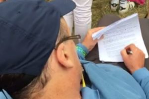 A Teacher Was Spotted Correcting Homework During Liam Gallagher's Glastonbury Set 11