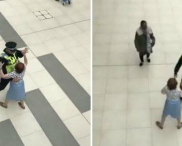 Heart-Warming Moment Police Officer Dances With An Elderly Lady In a Shopping Centre 2