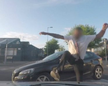 Furious Motorist Stamps On Woman's Car And Throws His Coffee At Her Because He Spilled His Drink When They Almost Collided 6