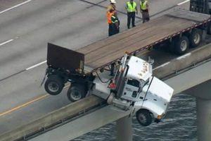 Driver Escapes Truck's Cab After Semi Dangles Off a Florida Bridge 12