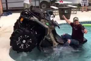 Here's A Man Driving An ATV Into A Swimming Pool While Holding A Beer, For Some Reason 10