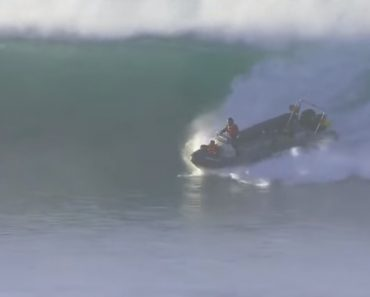 Boat Casually Surfs Massive Waves 7