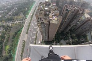 Daredevil Takes Morning Stroll On High Rooftop 11
