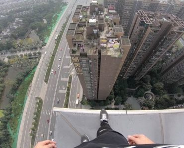 Daredevil Takes Morning Stroll On High Rooftop 7